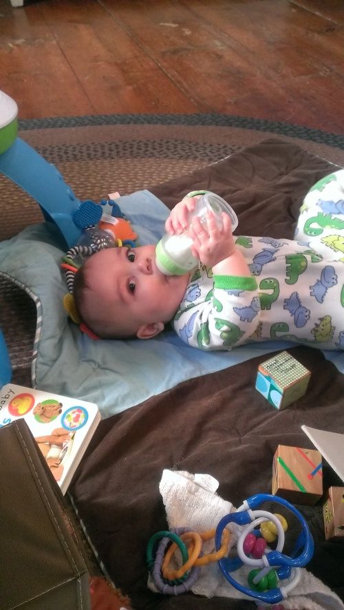 Another brand new skill- he can eat a whole bottle on his own!